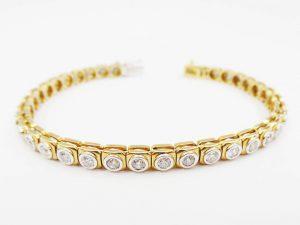 Lotto 98237 Bracciale in oro bianco in oro giallo con brillanti Base d'asta: 600,00 € - Cauzione: 60,00 €